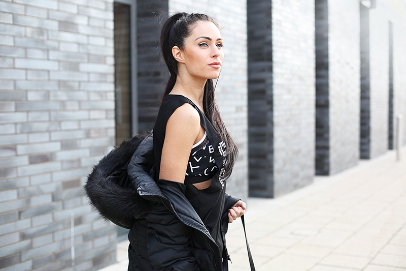 girl in fitness crop top and vest outside monochrome